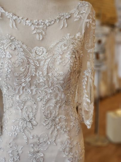 A three-quarter length sleeve by Maggie Sottero