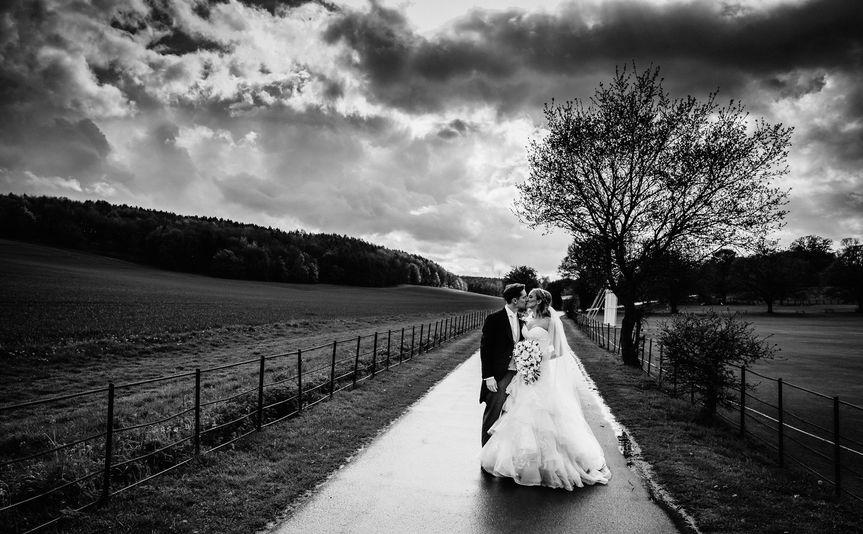 Newlyweds kissing - Imagine if Photography