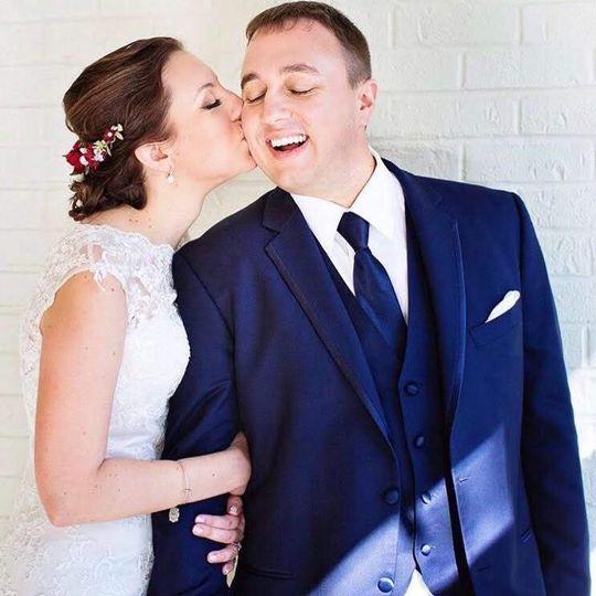 Kissing her groom