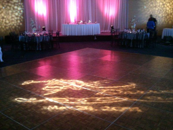 Custom design with the couple's names and date projected onto the dance floor.  We also have fabric...
