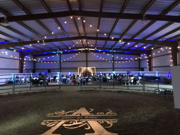 Wedding lighting in a large horse arena
