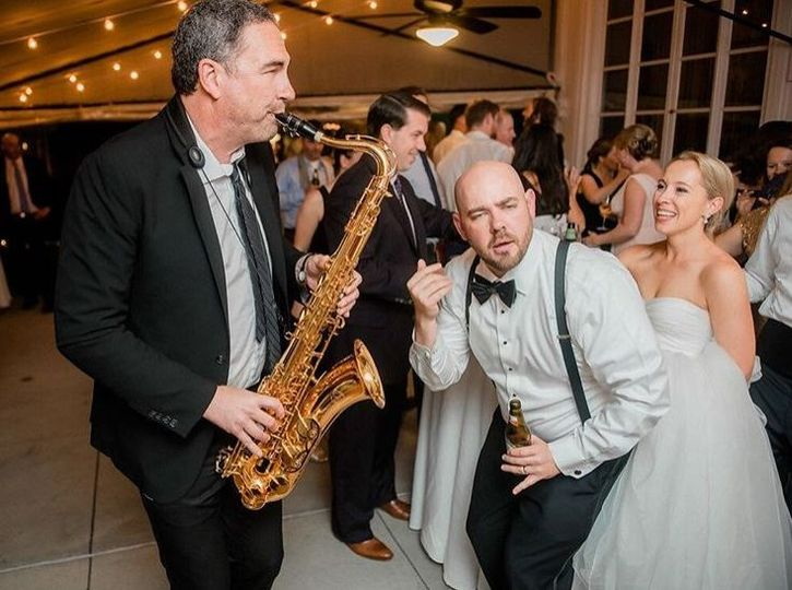 Saxophone player performing for newlyweds