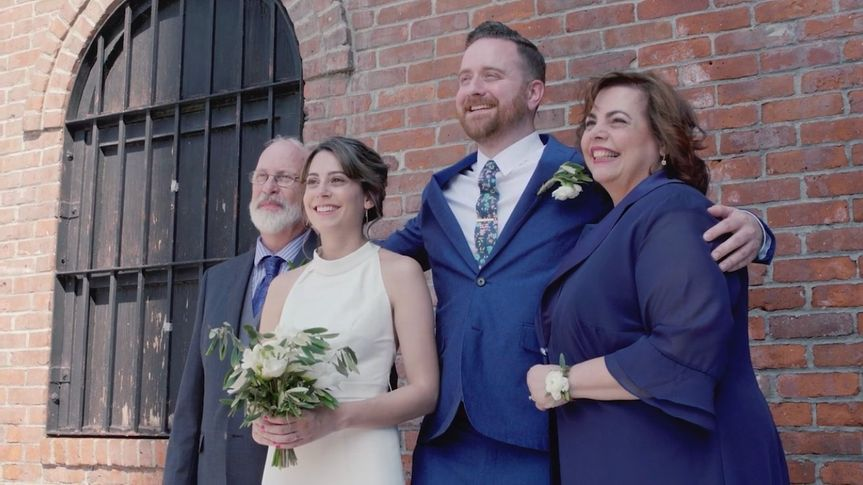 Newlyweds with loved ones