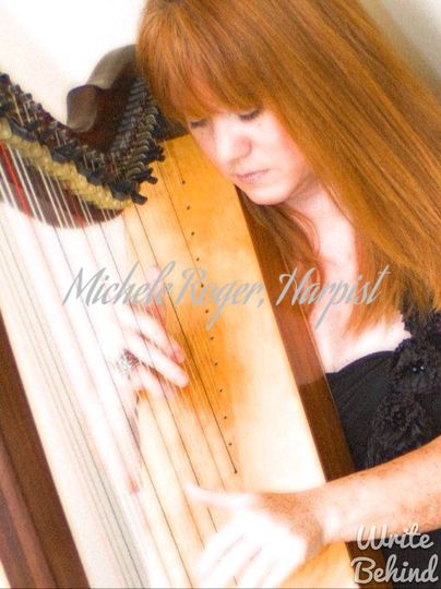 Michele Roger playing the harp