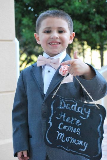Ring Bearer with sign by Brittany Harmening Photography in St. Petersburg