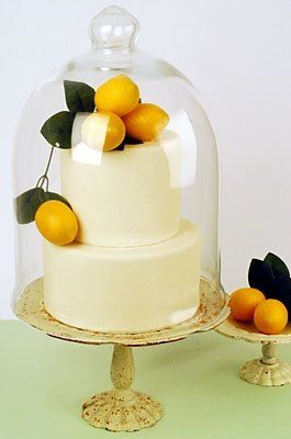 Brown butter cake with lemon cream filling covered in white fondant with myer lemons and leaves