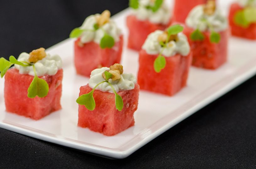 Bite Size Cubed Watermelon with Blue Cheese topped with a Candied Walnut
