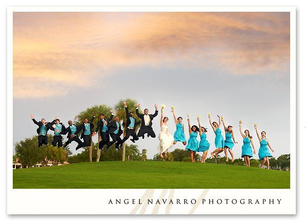 The entire bridal party jumps in the air for a late afternoon portrait.