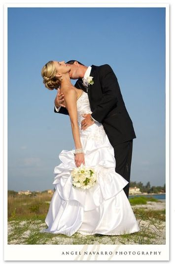 A sensual kiss at the beach after their wedding ceremony at Lido Key Beach in Sarasota, Florida.