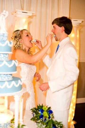 The couple having a taste of their cake