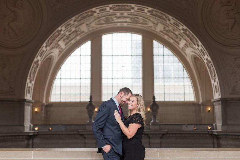 A couple in front of an arched window