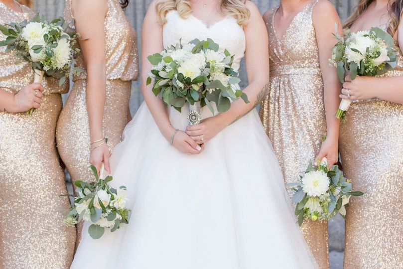 The bridal party holding their bouquets