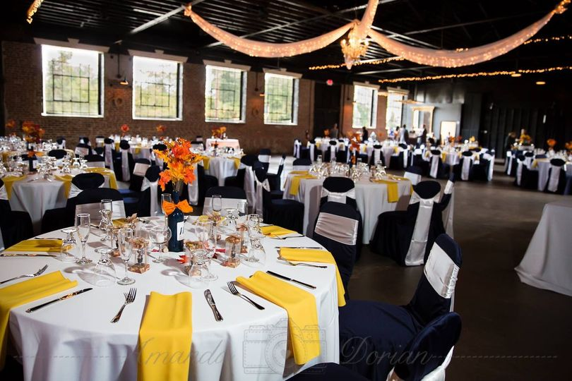 Yellow table napkins and navy chair covers