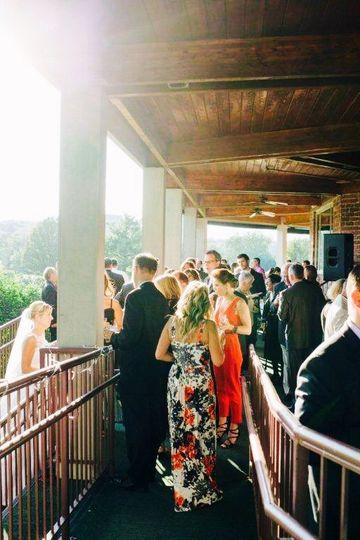 Wedding guests on veranda