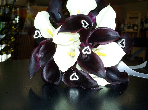 Hand tied bouquet of calla lilies