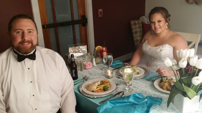 A happy couple get a private moment to enjoy their first meal together as Mr. & Mrs.!