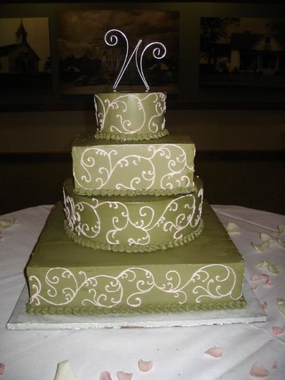 Green wedding cake with white piping