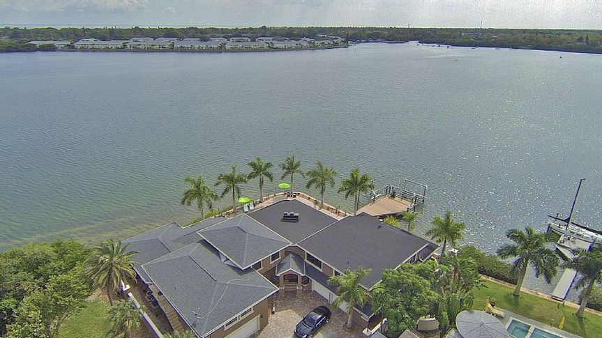 Aerial view of the property and the sea