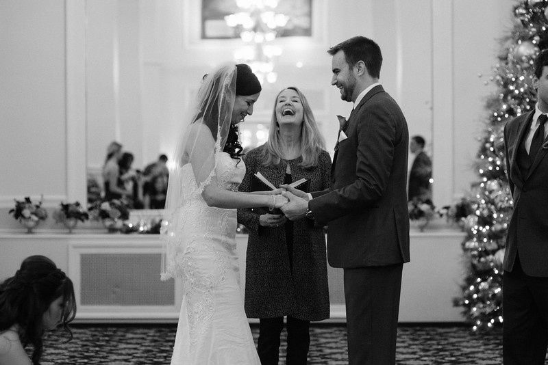 Happy couple and officiant