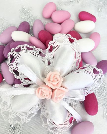 Our Cucore Style Coccarde!A beautiful confetti flower, known as coccarde! Each petal holds a...