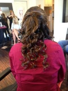 Long hair, curled and pinned for a bridesmaid.
