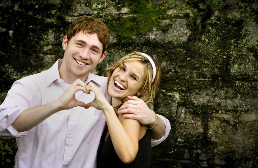 couple making heart shapes