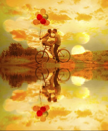 couples with balloons on bike