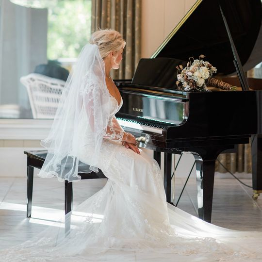 Bride by the grand piano
