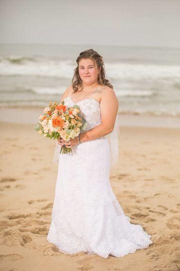 By the beach | Gown: Casablanca