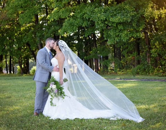 Newlyweds share a kiss | Gown: Maggie Sottero