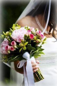 A classic!  Soft pink peony, green mini cymbidium orchids, bright pink spray roses.
