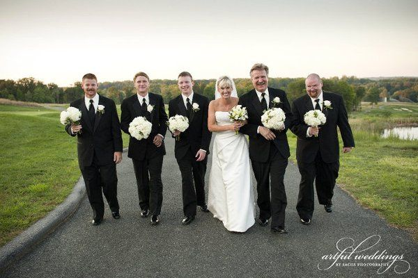 The men look so handsome carrying the bouquets!