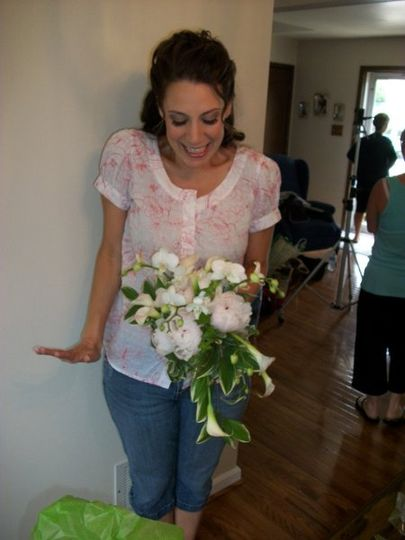 She's so excited - holding her bouquet for the first time!  Peony, mini callas, phalenopsis orchids,...