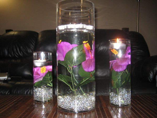 Three cylindrical vases...9 inches, 12 inches, and 16 inches height.. filled with silk purple...