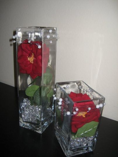 beautiful rectangular dual centerpiece..includes two rectangular vases, one roughly 5 inches high...
