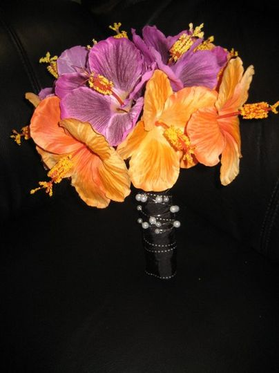 This is a beautiful orange and purple silk flower bouqet..the bottom is wrapped in black satin...