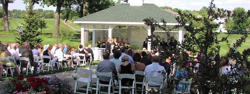 Wedding venue with guests and couple
