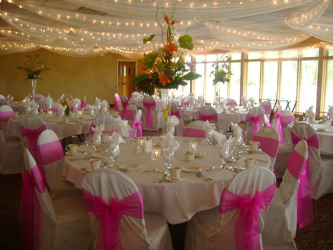 Wedding reception decor with pink accent