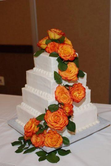 4-tier wedding cake with orange flowers