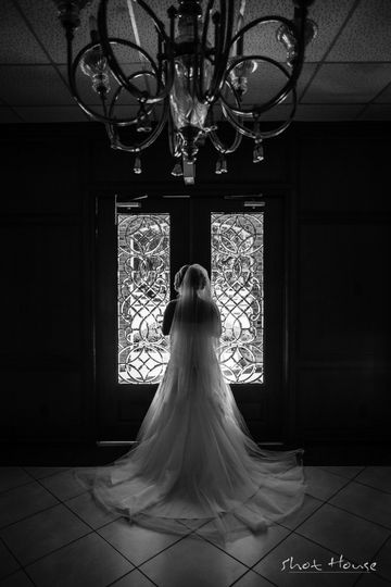 A beautiful bride stands waiting in her beautiful dress