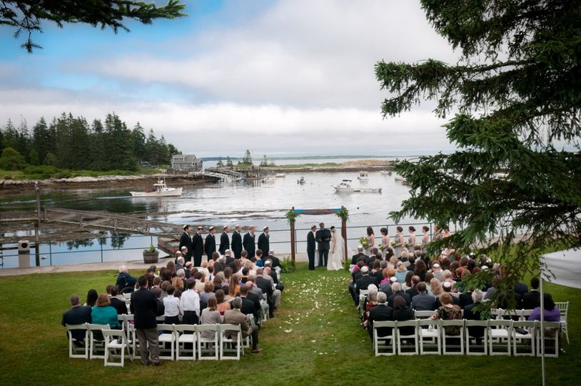 A ceremony on the event lawn overlooking the Newagen Harbor.