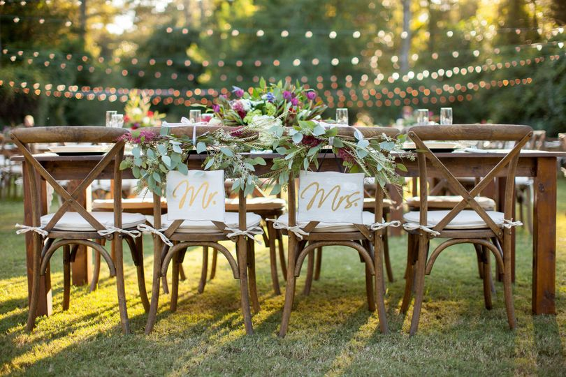 Head table with farm table and crossback chairs at Burge Plantation in Monroe, GA.