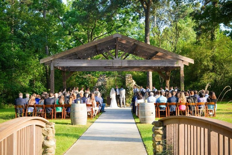 Rustic Rose has a breathtaking ceremony area. Views of the lake, wishing well, bridge, and our 400...