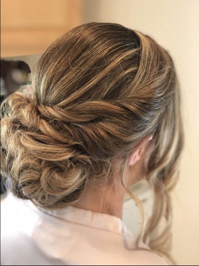 Wavy hair tied into a low bun