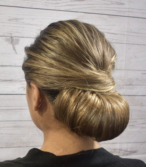 Hair tucked into low bun