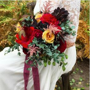 Bride holding her red bouquet