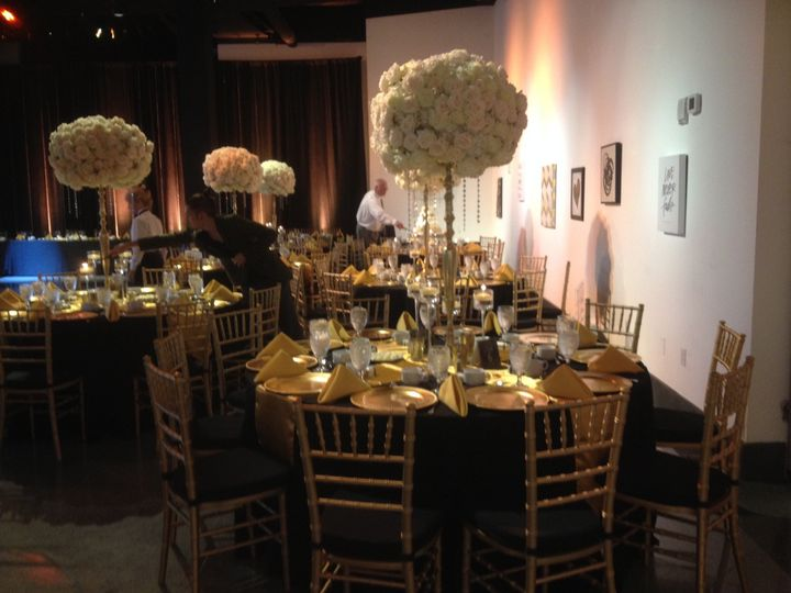 Black tables and gold decor