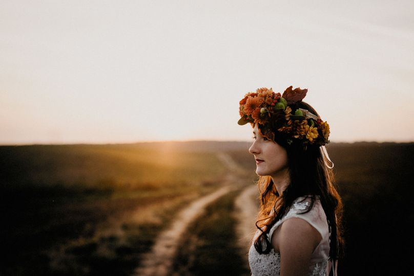 Autumn bridal portrait during an after-wedding photo session which took place on a field in the...