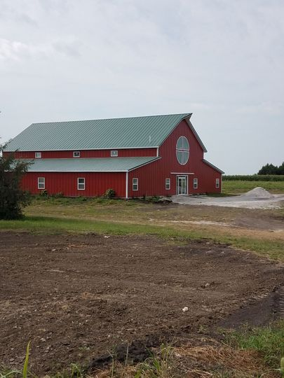 A traditional red barn with green roof, but fully modern with wide open space inside and every...