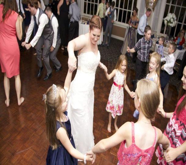 Kids and bride dancing